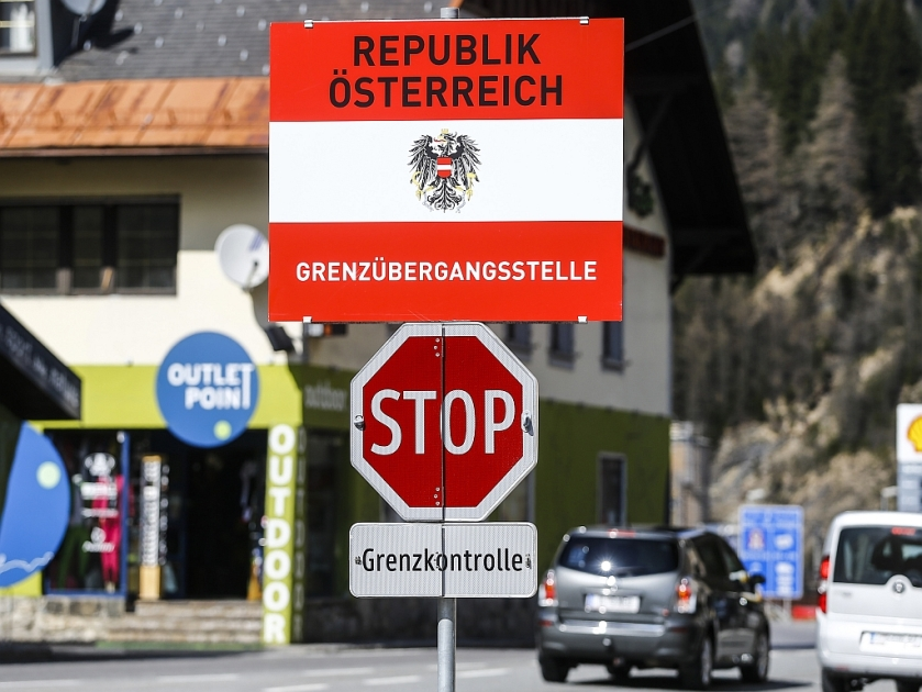 "A border sign reading ""Republic of Austria - border control"" is seen in the Italian village of Brenner"